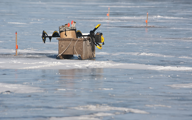 Ice fishing equipment on a frozen lake
