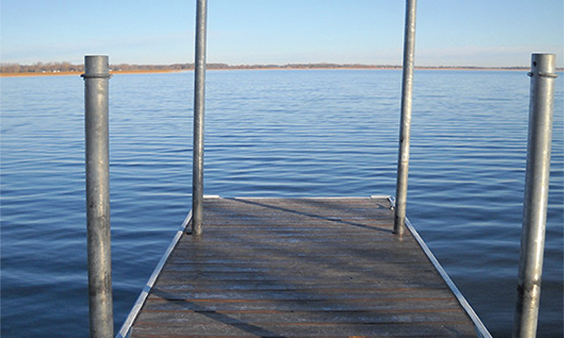 end of a dock looking over lake osakis